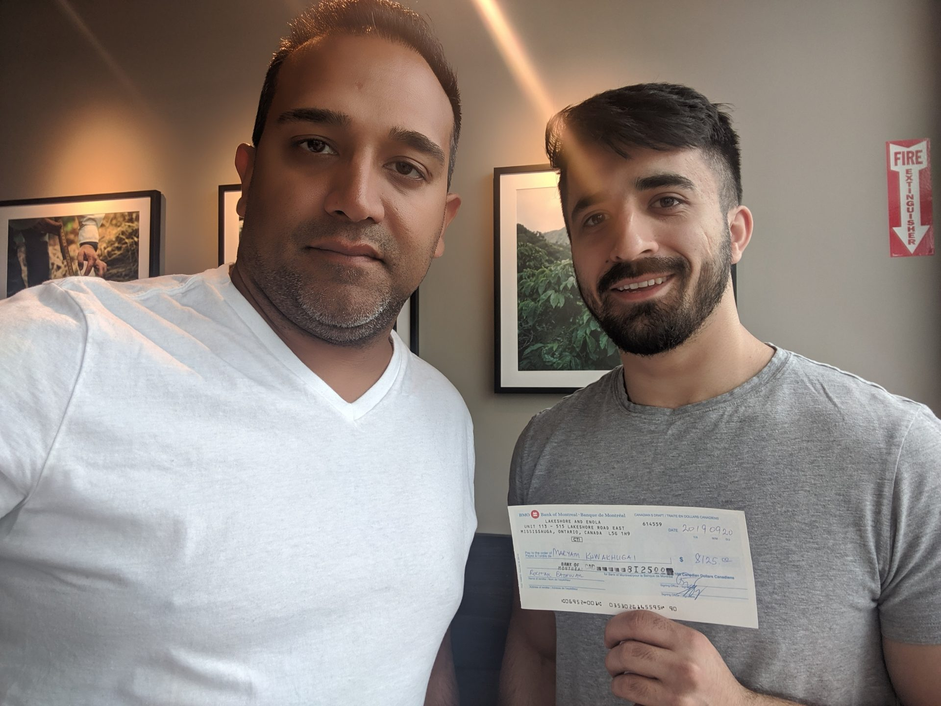 rocky holding a cashback check with a customer